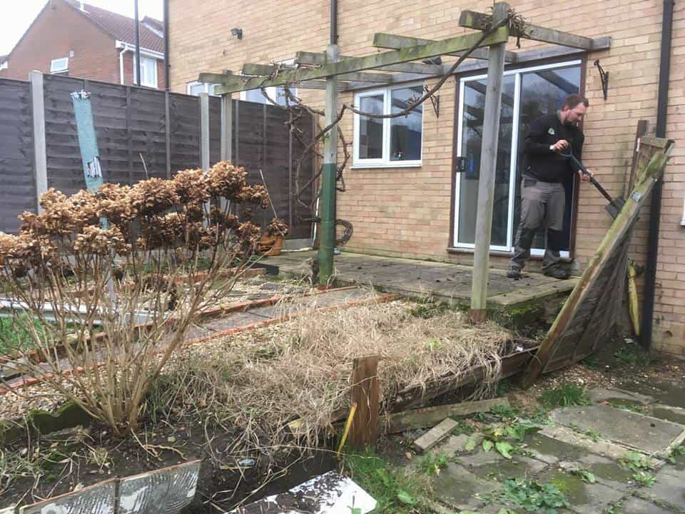 Removing the old fencing as part of a replacement fence project in Southampton