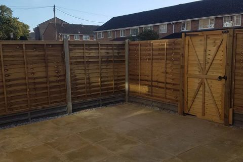 Green Overlap Fencing Panels with Concrete Gravel Boards and Matching Gate in Weston, Southampton